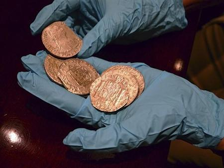 Gold coins from a treasure trove of gold and silver