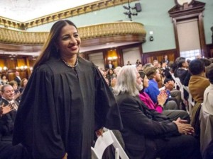 Newly appointed city judge, Chennai-born Raja Rajeswari, rises to take her place for a Judicial Swearing-In Ceremony at New York City Hall in New York on Monday.