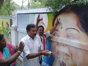 AIADMK cadre celebrate Jayalalithaa's acquittal with an offereing of milk in Madurai.